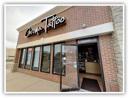 Image of Chroma Tattoo storefront with a view of the interior through the open front door